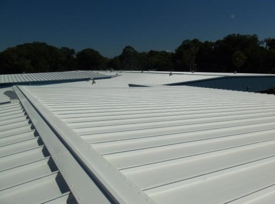 Commercial roof with an applied ElastiKote spray coating
